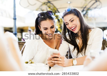Two young girls talking and smiling during lunch break #285433802