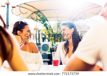Shutterstock Two young girls talking during lunch break