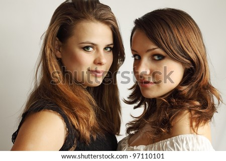 Two young girls tenderly embracing each other