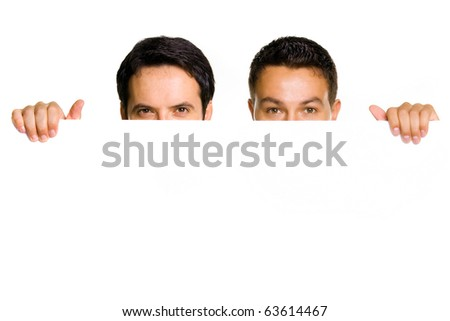 Two young guys holding a blank billboard, studio shot