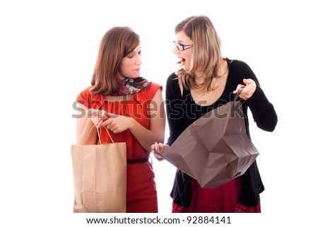 Two young happy excited women shopping, isolated on white background.