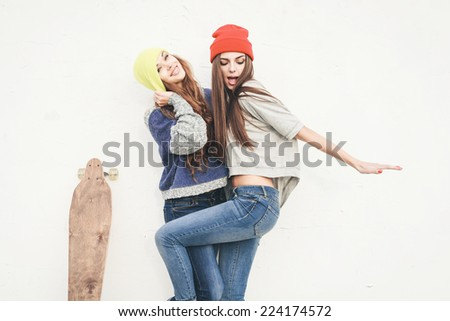 two young hipster girl friends...