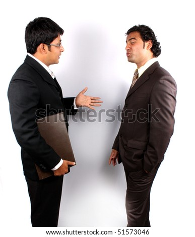 Two young Indian businessman in an argument.