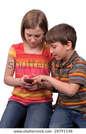 Two young kids texting messages on a smart phone