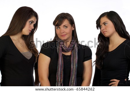 Two young lady's looking upset at their sister who is looking embarrassed.