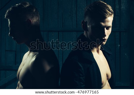 Two young male twins with sexy body showing their muscular torso and abs in studio #476977165