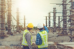 Two young man architect on a building construction site