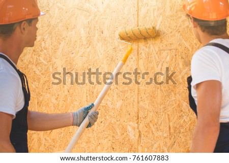 Two young man building wooden house. Ecology concept. #761607883
