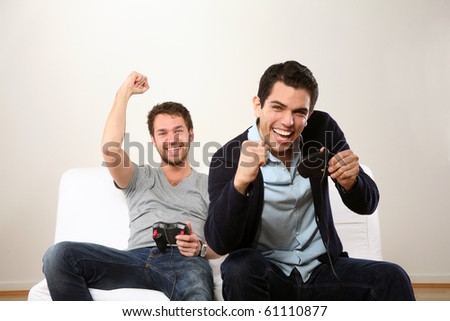 two young man playing and smiling