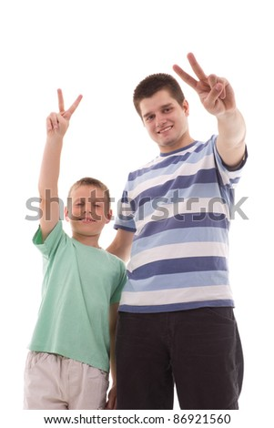 Two young man pointing a victory - stock photo