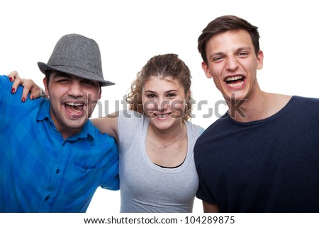 Two young men and a young woman isolated over white background.