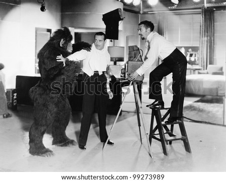Two young men looking feared being attacked by a gorilla
