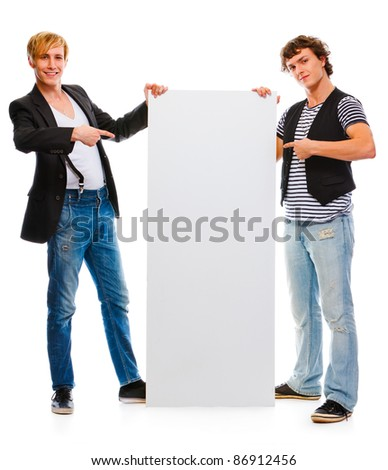 Two young men pointing on blank billboard. Isolated on white