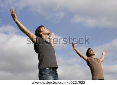 Two young men with there arms wide open enjoying life