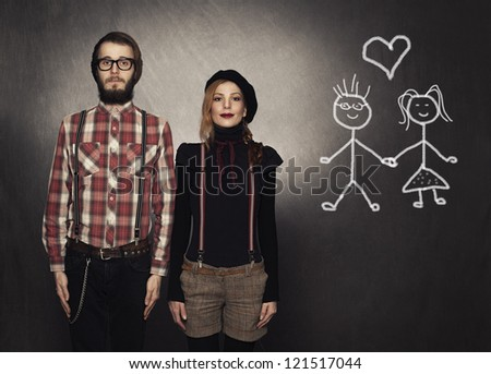 two young nerds in love with their drawings on grunge background