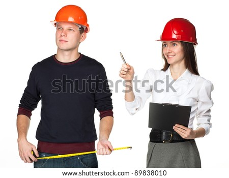 Two young people in hardhats discussing construction process; isolated on white