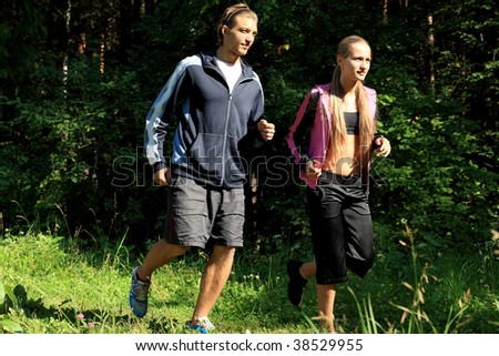 Two young people running together in the morning.