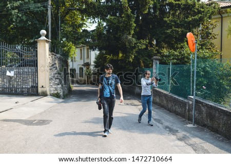 two young photographers walking and making pictures