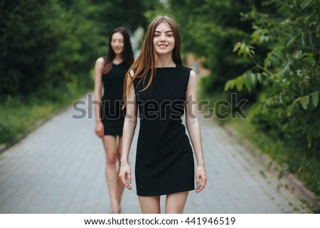 two young pretty woman in a little black dress  #441946519