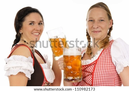 Two young pretty women in dirndl with beer mug / munich beer festival
