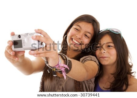 two young sisters making a photo of them self (selective focus)