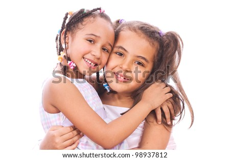 Two young sisters smiling