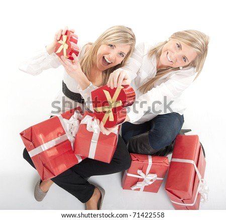 Two young sisters surrounded by gift boxes, some of them heart shaped