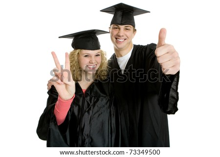 Two young smiley graduate students in cap and gown