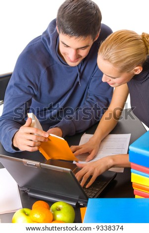 Two young students with books and laptop studying, isolated