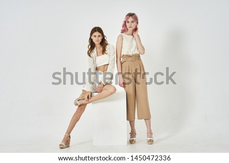 two young stylish women fashion #1450472336