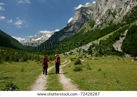 Two young trekkers walking along a mountain path, Ropojana Valley, Montenegro
