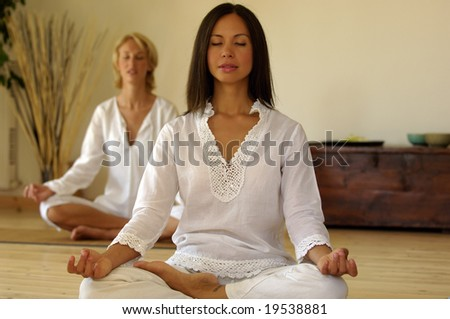 Two young woman doing yoga