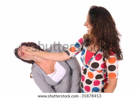 Two young woman fighting, a slapping in the face