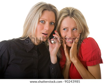 Two young woman listening a phone call