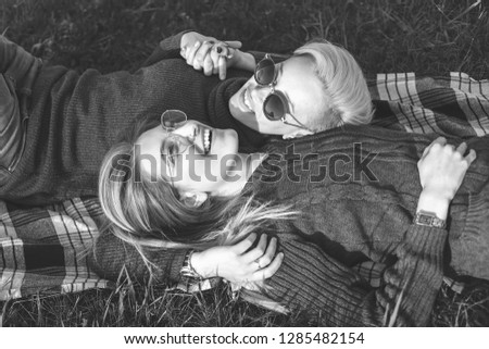 Two young women are lying outdoors. Black and white #1285482154