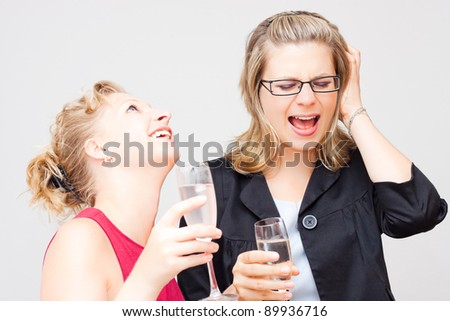 Two young women enjoying party.