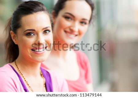 two young women friends closeup portrait
