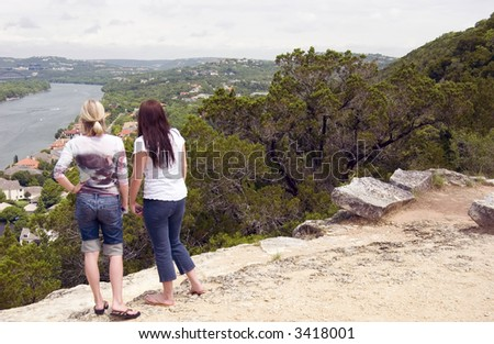 Two young women gazing out at the magnificent view