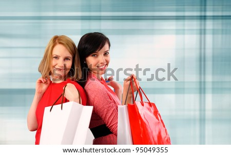 Two young women holding shopping bags