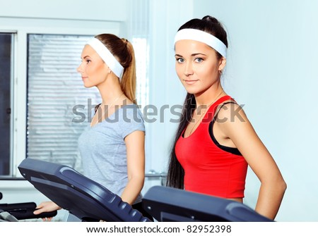 Two young women in the gym centre.