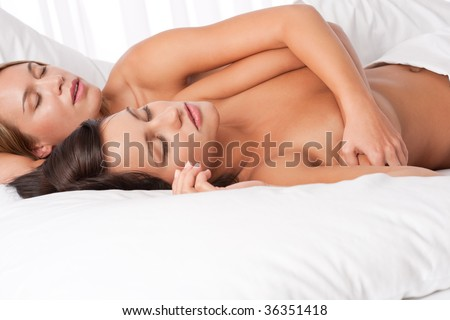 couple sleeping in bed together naked