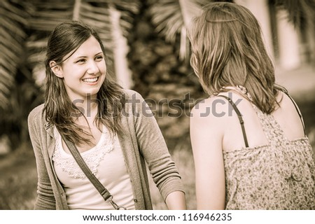 Two Young Women on a Bench at Park , Italy