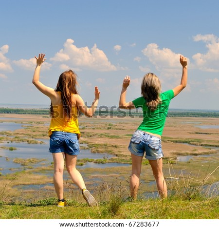 two young women outdoor in summer