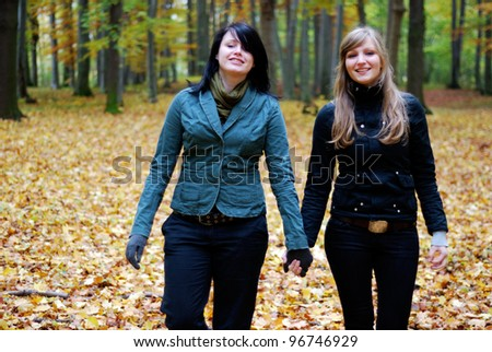 two young women outdoors in autumn