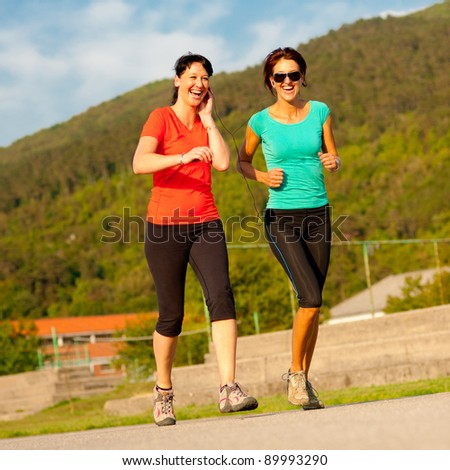 Two young women running outdoor