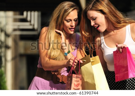 two young women sharing their new purchases with each other