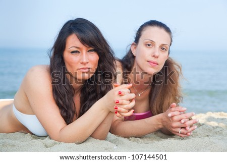 Two Young Women Sunbathing