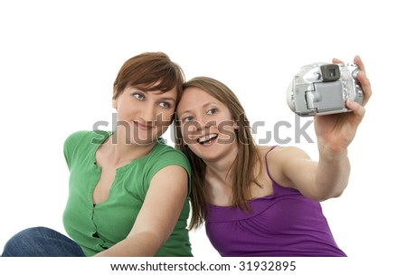 Two young women taking a self-portrait with a digital camera.