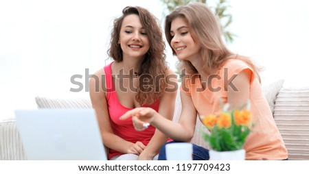 two young women talking and sitting down at the coffee table #1197709423