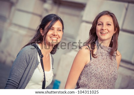 Two Young Women Walking in the City